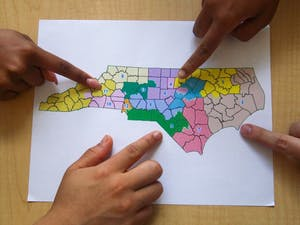 DTH Photo Illustration. NC judges order district lines to be redrawn ahead of the 2020 election in an attempt to limit gerrymandering.