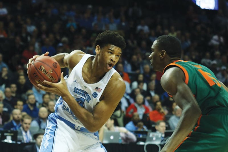 North Carolina forward Isaiah Hicks (4) works on a Miami defender in the quarterfinals of the ACC Tournament in Brooklyn on Thursday.