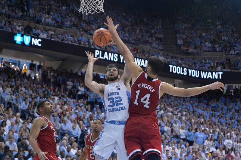 North Carolina forward Luke Maye (32) goes up for a layup against N.C. State center Omer Yurtseven (14) on Jan. 27 in the Smith Center.