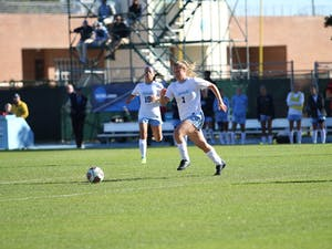 First year Madison Schultz (1)dribbles the ball downfield Saturday against Liberty.