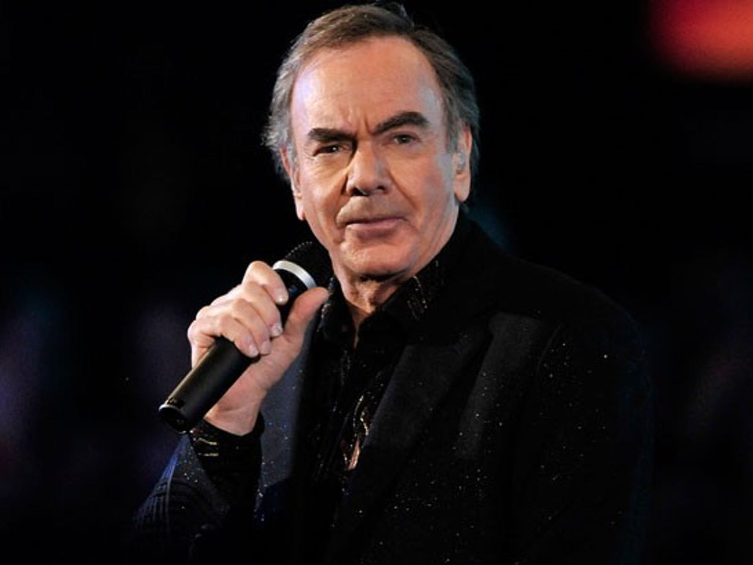 Neil Diamond delivers his signature brand of soft rock live and in person. Courtesy of  Legacy recordings