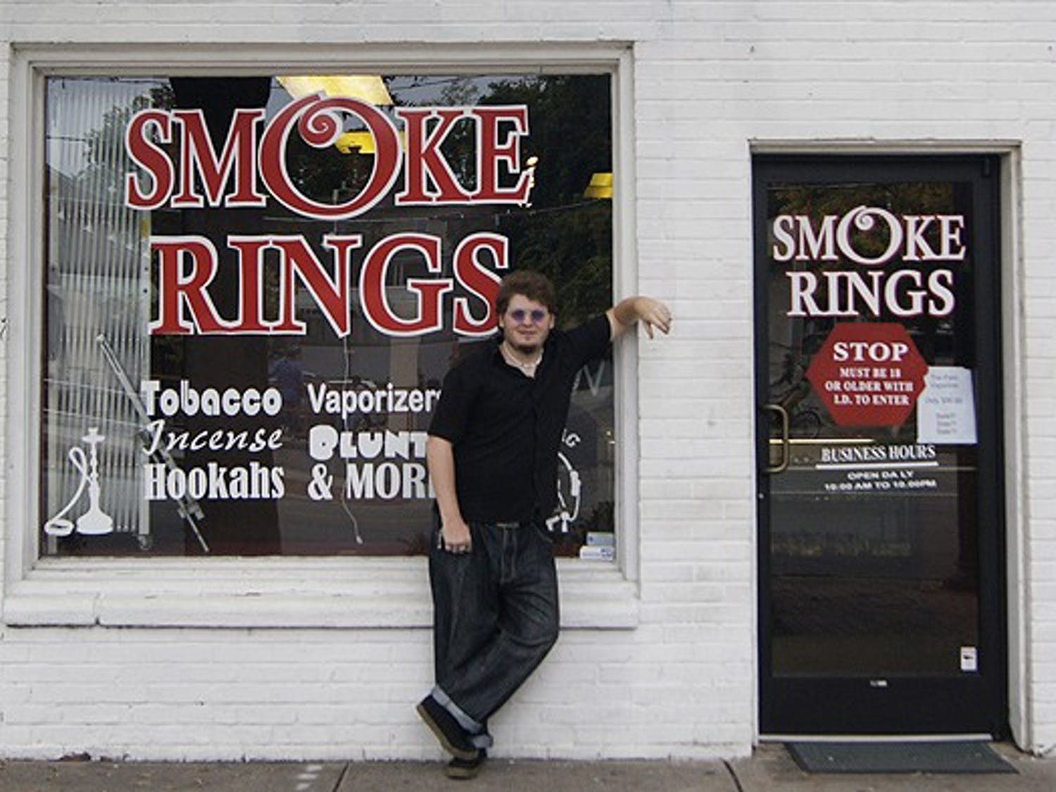 """Larry Webster, known as """"Crazy Larry"""" to his customers at the Smoke Rings smoke shop, has dreamed of working on Franklin St. since he was a kid.  He doesn't believe the county wide ban would affect the store's business terribly."""