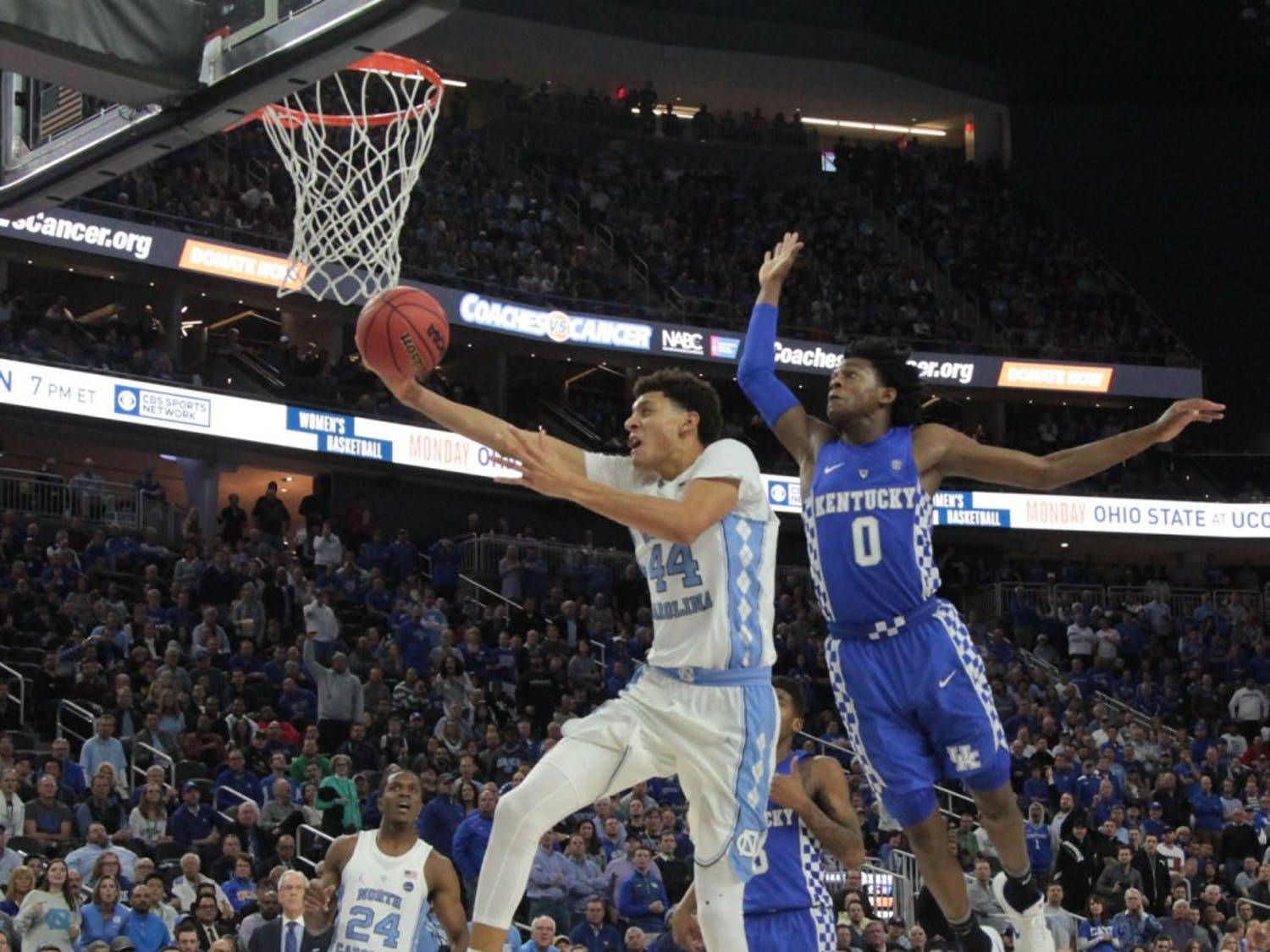 UNC forward Justin Jackson (44) goes for a contested layup against Kentucky on Saturday.