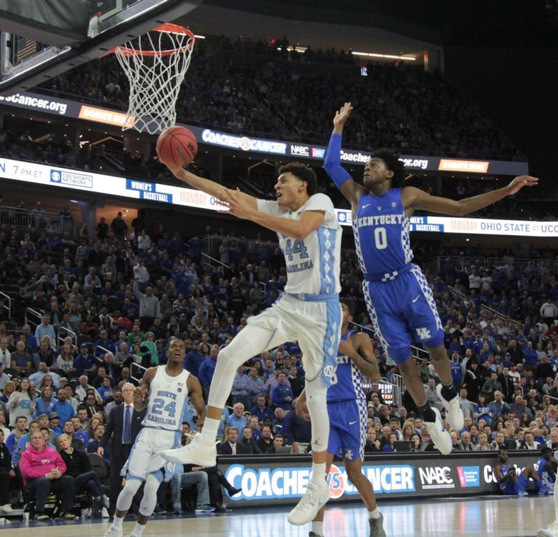 The No.7UNC men's basketball team fell to No.6 Kentucky 103-100 in the CBS Sports Classic in Las Vegas on Saturday.
