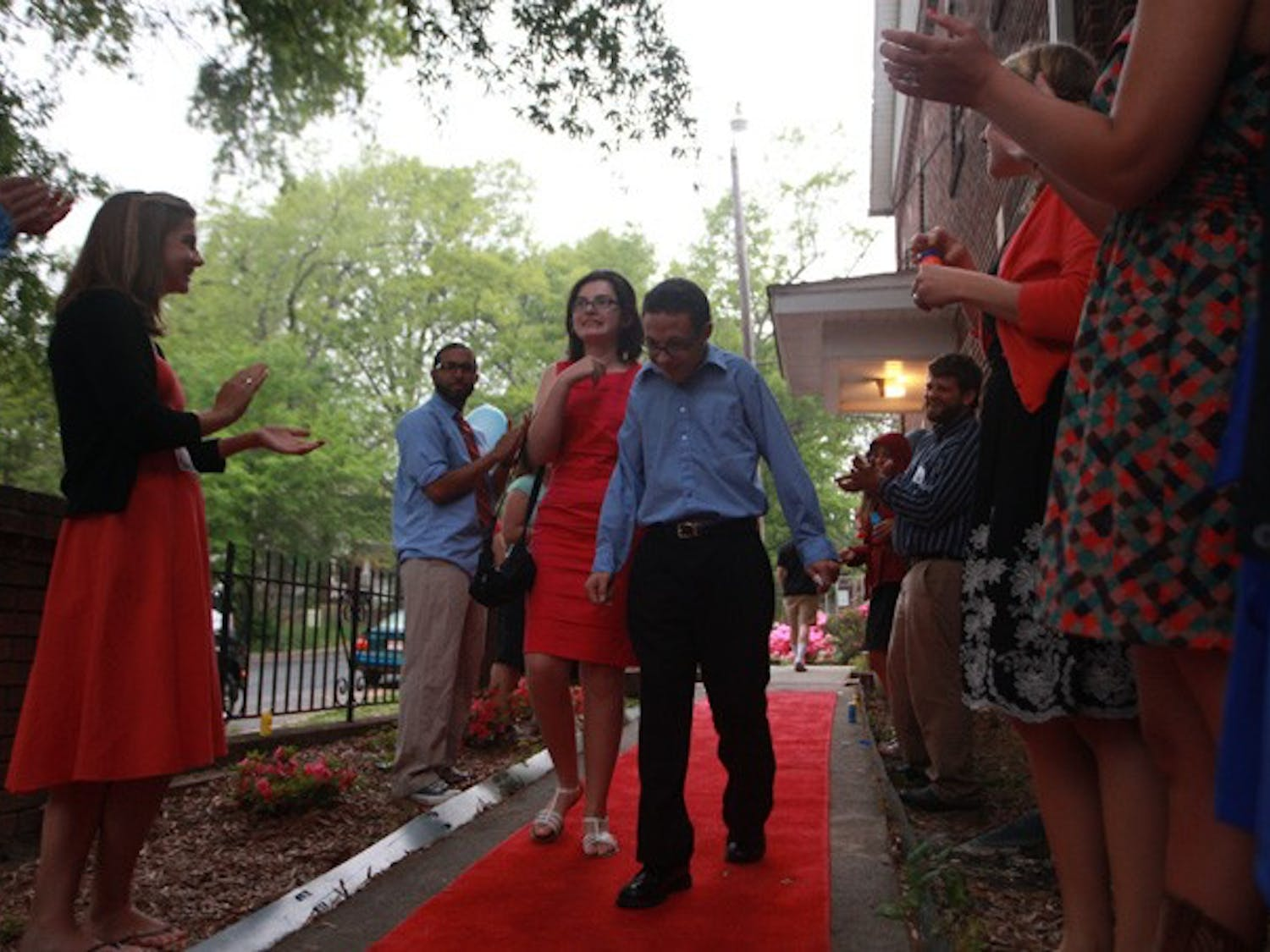 Zoe Kofodimos, 15, and her date, Aaron, are applauded as they walk the red carpet to enter the dance.