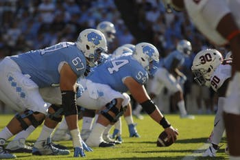 North Carolina's offensive line prepares for a play against Virginia on Saturday.