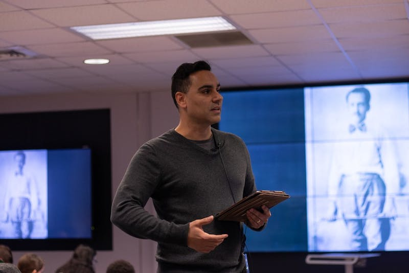 Associate Professor Miguel La Serna lectures his HIST 248: Guerrillas and Counterinsurgencies in Latin America class. in Greenlaw Hall on Tuesday, Feb. 11, 2020. La Serna takes an experimental approach to teaching by making use of audio and video technology to immerse his students in the material.