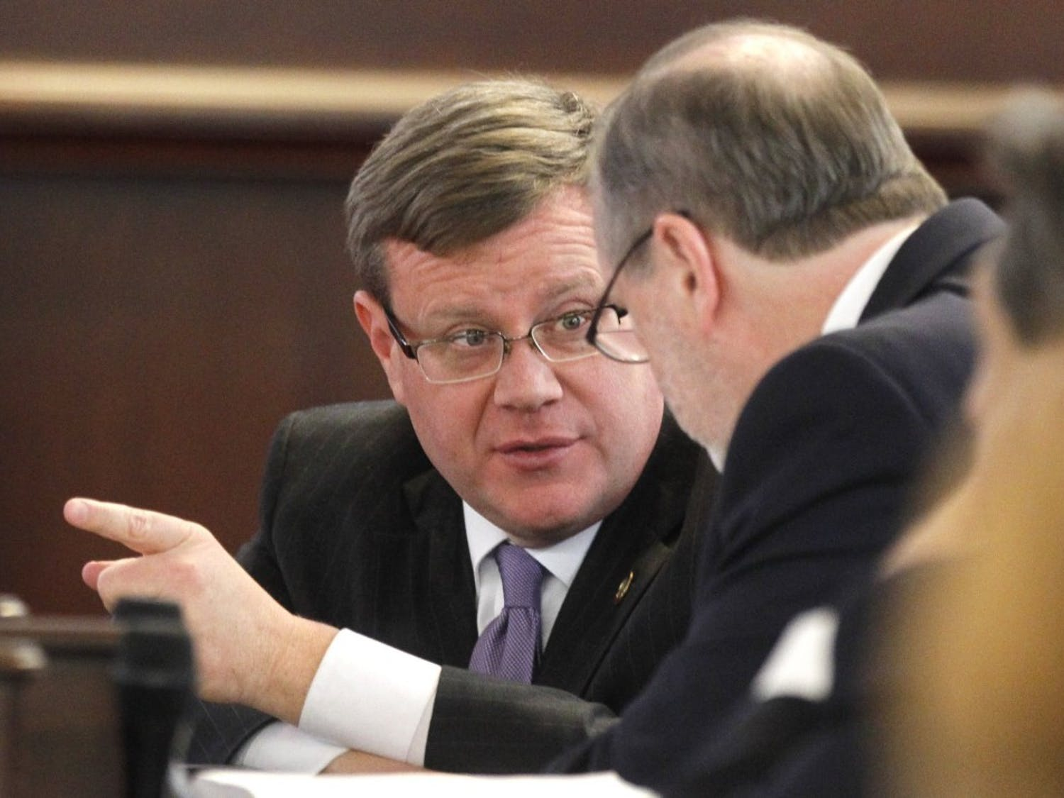 North Carolina Speaker of the House Tim Moore, left, confers with President Pro Tempore Phil Berger in the Senate chambers during a special session of the North Carolina General Assembly on Friday, Dec. 16, 2016 at the Legislative Building in Raleigh, N.C. (Ethan Hyman/Raleigh News & Observer/TNS)