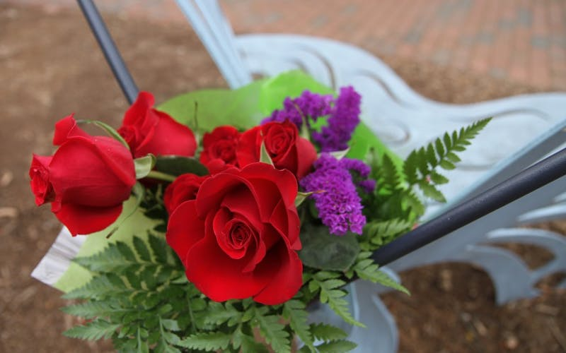 An anonymous donor/community member left a bouquet of roses on the Eve Carson Memorial Butterfly Bench (Note: UNC cites this a few different ways on the website, so check with management on the CQ) last December. [I'm pretty sure it's legit to say that] The bouquet was left during the trial of Laurence Alvin Lovette Jr. in December. Someone sent Steven an email about this, so he might have more ideas/info about the caption. Also, some of these could be cool as a cut-out in a recap package/spread or something. P.S. GO TEAM PHOTO