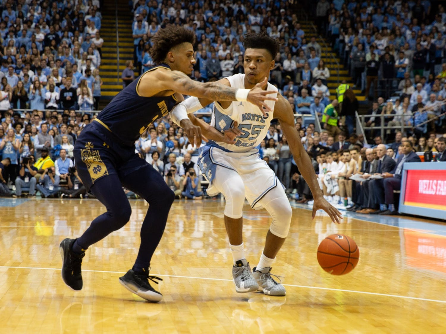 UNC guard Christian Keeling (55) dribbles the ball in the game against Notre Dame on Wednesday, Nov. 6th, 2019 at the Dean E. Smith Center. UNC won the game 76-65.