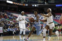 North Carolina junior guard Shayla Bennett drives past Notre Dame's Jackie Young in an ACC Tournament second-round matchup on March 8, 2019.