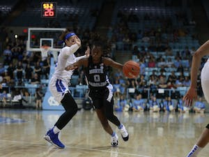 Junior guard Shayla Bennett (0) drives down the court during a game against Duke in Carmichael Arena on Thursday, Feb. 7, 2019. UNC lost 69 to 85.