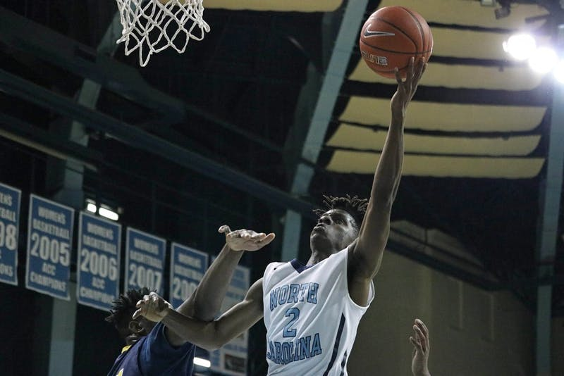 North Carolina guard Robby Wuo (2) goes for a layup against Northwood Temple Academy. The Tar Heels defeated Northwood Temple Academy 101-69.
