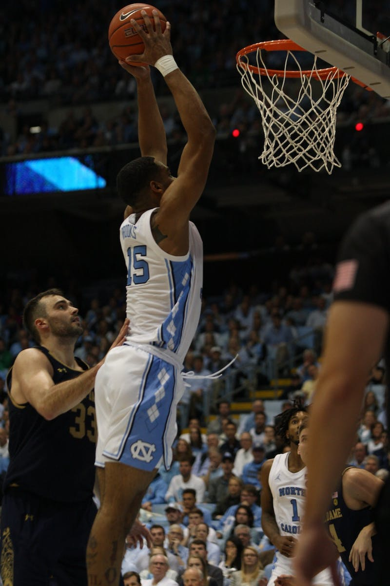 UNC forward Garrison Brooks (15) dunks during the Notre Dame on Wednesday, Nov. 6, 2019 in the Dean E. Smith Center. The Tar Heels beat the Fighting Irish 76-65.