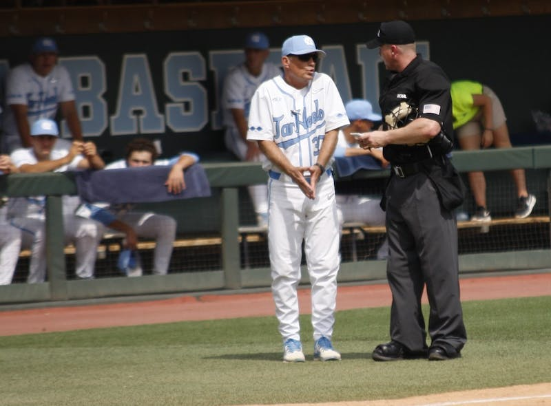 UNC baseball head coach Mike Fox argues with the umpire after a call  during the first round of the regional championships on Friday May 31, 2019. UNC beat UNCW 7-6.