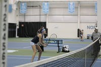 First-year Cameron Morra prepares to receive a serve during a doubles match against East Carolina University at the Cone-Kenfield Tennis Center in Chapel Hill, NC on Wednesday, Jan. 23, 2019. Morra and her partner, Makenna Jones, won both sets in the match.