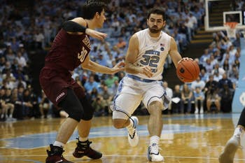 Harvard forward Danilo Djuricic (30) guards UNC forward Luke Maye (32)  in the Smith Center Wednesday, Jan. 2, 2019. UNC defeated Harvard 77-57.