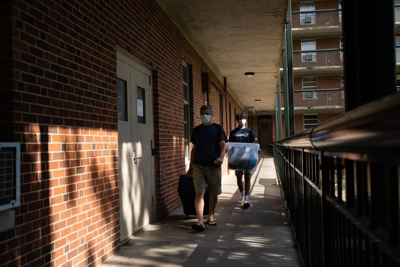 A first-year previously living in Craige Residence Hall moves out with the help of his dad on Tuesday, Aug. 18, 2020 following UNC's announcement that all classes will be moving to an online format.