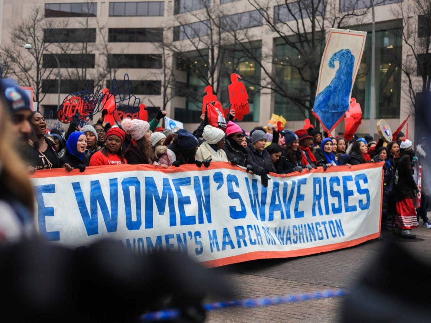 Thousands stand behind the Women's Wave Rises banner to mark the third annual Women's March on Washington since 2017.  The march began on Pennsylvania Avenue in front of the Trump International Hotel in Washington D.C. on Saturday, Jan. 19, 2019