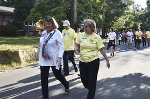 Mayor of Chapel Hill, Pam Hemminger and Mayor of Carrboro, Lydia Lavelle lead a walk around the neighborhood at the good neighbor block party at Hargraves Community Center in Aug. 2016.