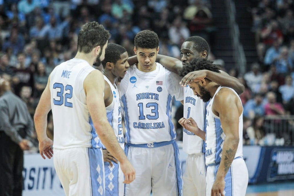 <p>North Carolina's starting five huddles during a loss to Texas A&amp;M in the second round of the NCAA Tournament on March 18 in Charlotte.</p>