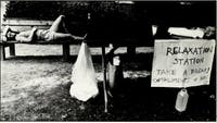 A student rests on a bench during move-in weekend, 1988. Courtesy of UNC'sYackety Yack yearbook.
