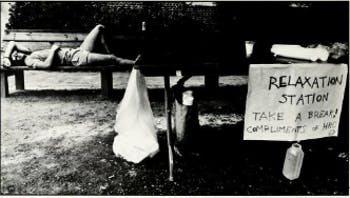 A student rests on a bench during move-in weekend, 1988. Courtesy of UNC's Yackety Yack yearbook.