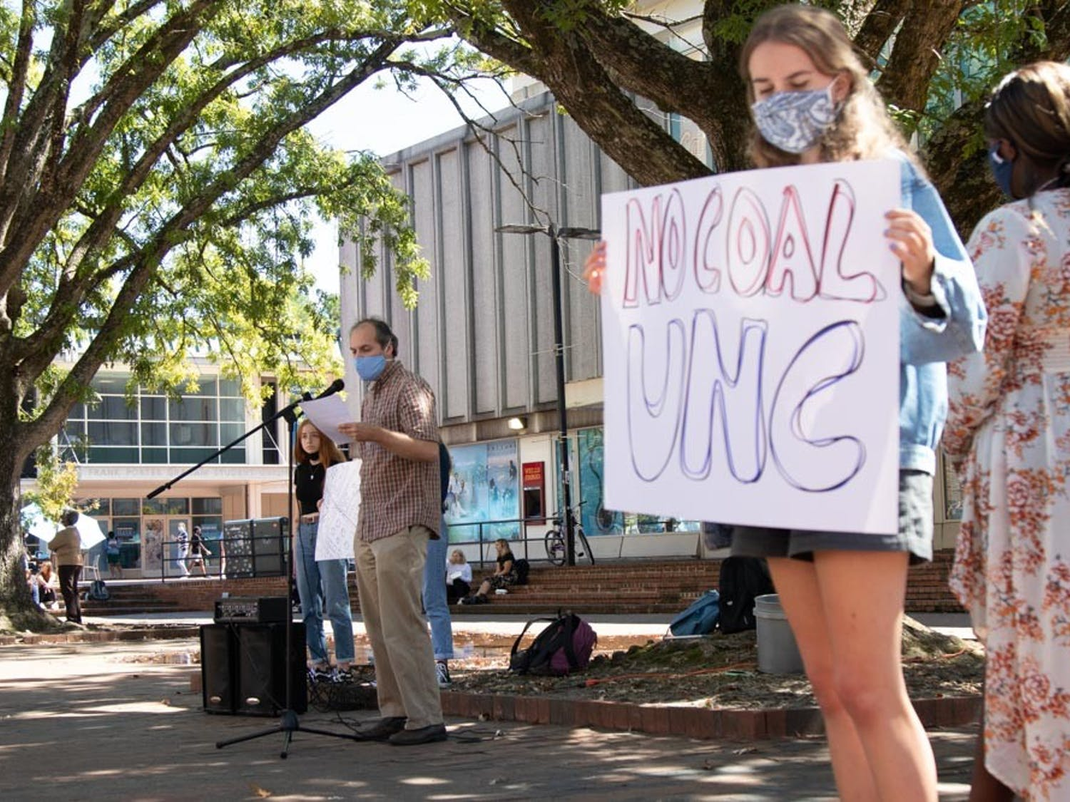 Students gather around The Pit to listen to Dr. Jason West during a protest against UNC's coal plant on Sept. 24, 2021.