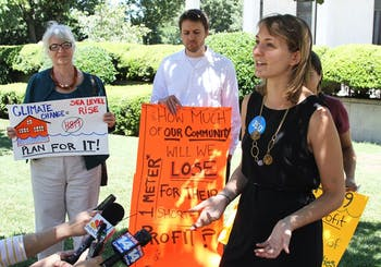 Jenny Marienau, field organizer for 350.org, voices her concerns about the Coastal Management Policies bill outside the NC legislature building on Tuesday.