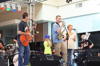 The Buzztown Band performs at the Not So Normal 5K at University Mall on Sunday.