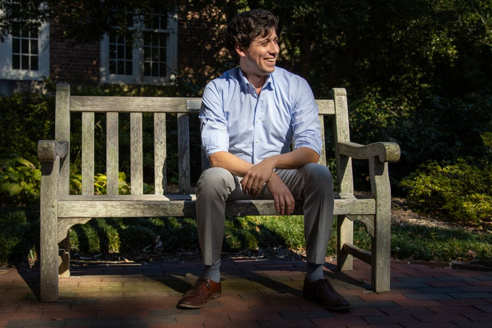 """Jonah Garson is running for the N.C. House seat that will be open after Rep. Verla Insko retires at the end of her term in December 2022. Garson poses for a portrait Monday in the Wellstone Memorial Garden on UNC's campus, named for political organizers that Garson said he looks up to. """"They were rockstars for left labor policies,"""" Garson said."""