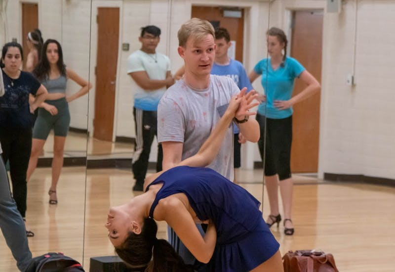 Junior Bennett Congdon and sophomore LeighAnn Halik demonstrate choreography while Qué Rico prepares for their Oct. 5 performance at Mi Pueblo's Carnival, on Thursday, Sept. 26, 2019.