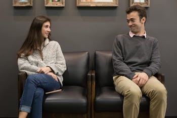 Juniors Marigny Strauss (left) and Trent Martensen sit next to each other inside of the local coffee spot, Tama Tea, as they portray the awkwardness of asking another person on the first date.