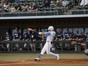 Junior second baseman Ashton McGee (5) swings sharp and fast at the ball during UNC's 12-3 win against Xavier on Friday, Feb. 15, 2019.
