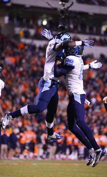 Eric Highsmith (right) and A.J. Blue celebrate after Blue scored a touchdown in the first half.