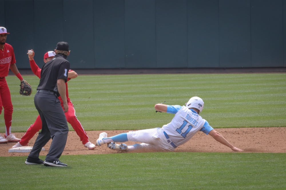 UNC sophomore outfielder/catcher Caleb Roberts (11) attempts to slide into second base during the Tar Heels' 1-6 loss against N.C. State on Saturday, March 27, 2021 in Boshamer Stadium in Chapel Hill, N.C.
