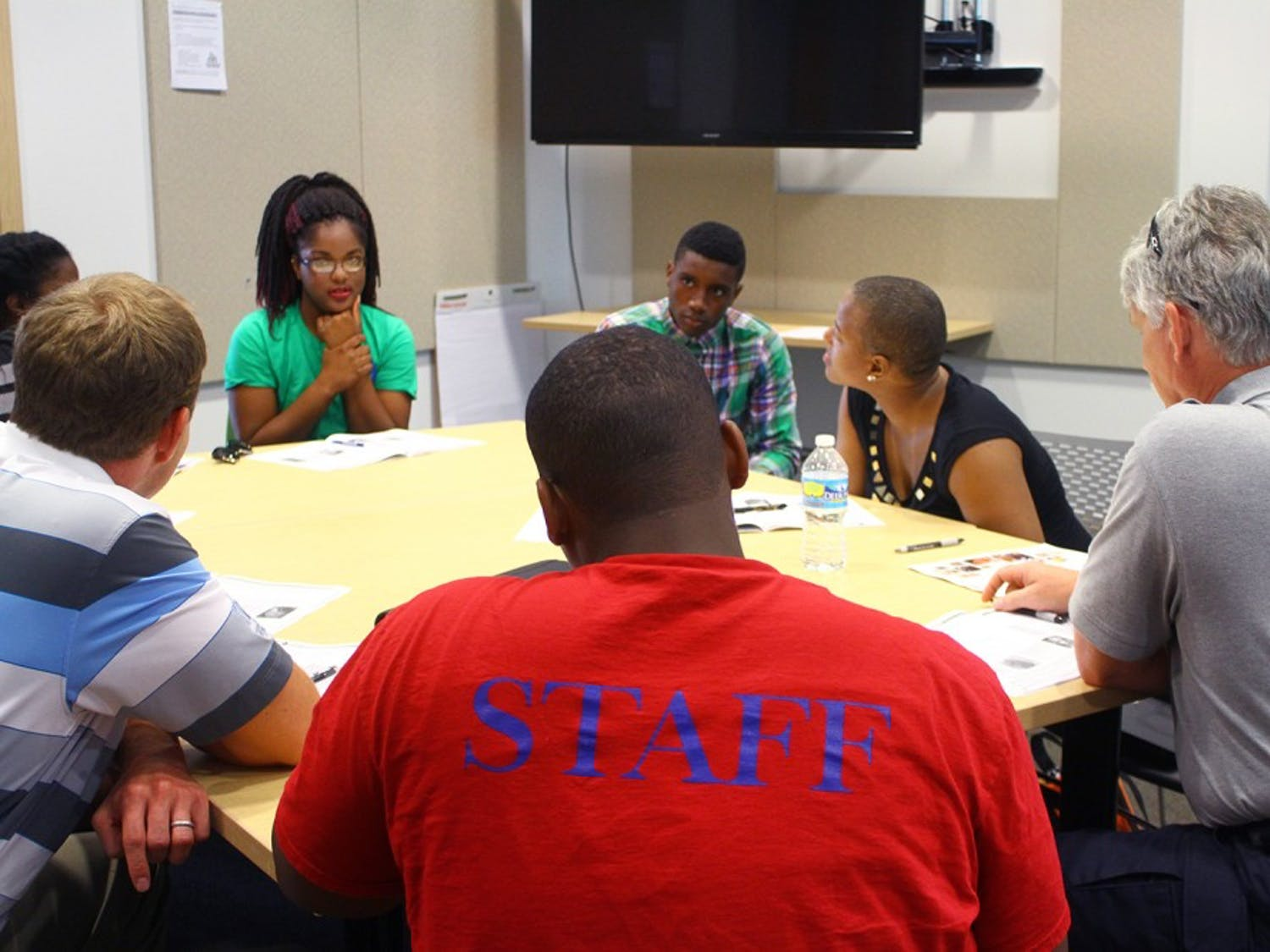 (Far left) Hargraves Community Center counselor Jazmine Mason-Carter brainstorms safety ideas with other trainees.