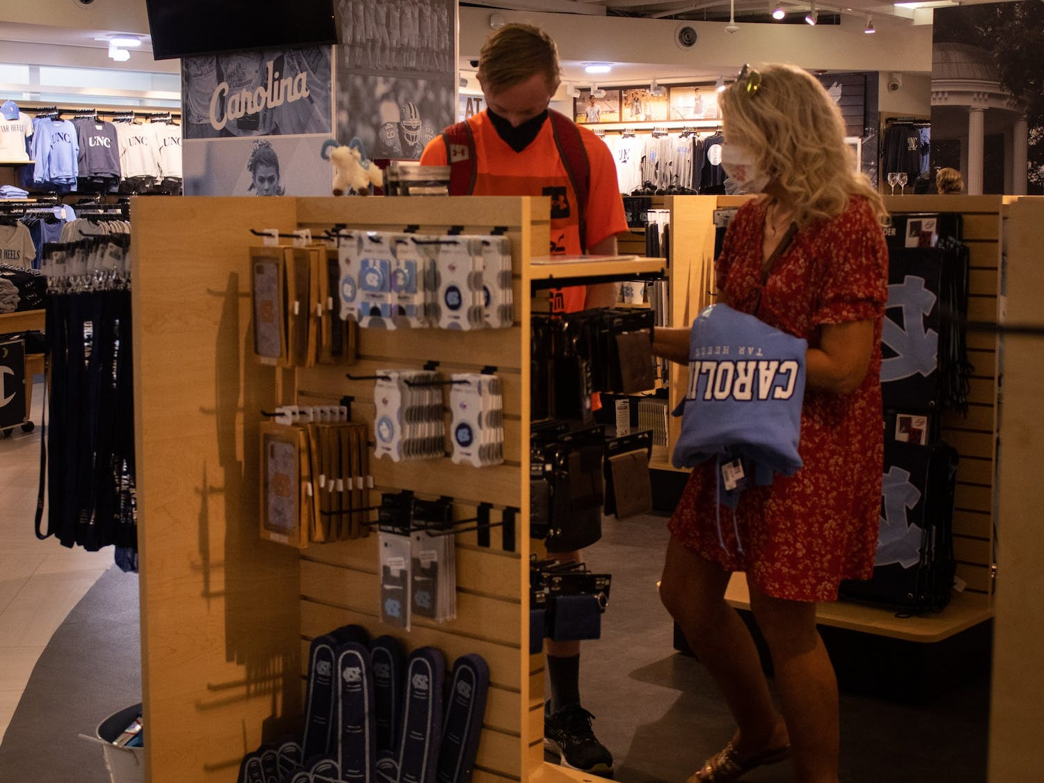 Prospective student Braden Holton and his mother Laura Holton from Pennsylvania shop for UNC gear at the UNC Student Stores on their trip to tour the University on Sept. 19.