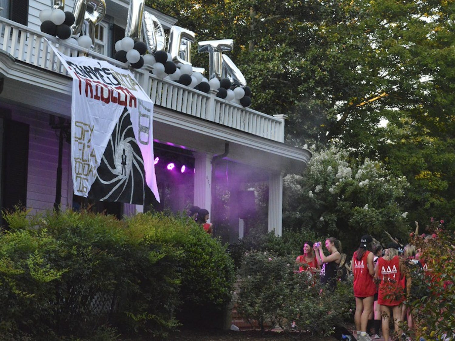 The Tri Delta house emitted pink smoke to set the atmosphere for the sorority's Bid Day celebration.