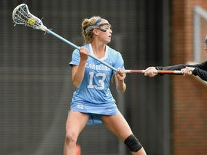 UNC's Caitlyn Wurzburger (13) looks to pass the ball during a game against Florida at Dorrance Field on Friday, February 19, 2021. Photo courtesy of Dana Gentry.