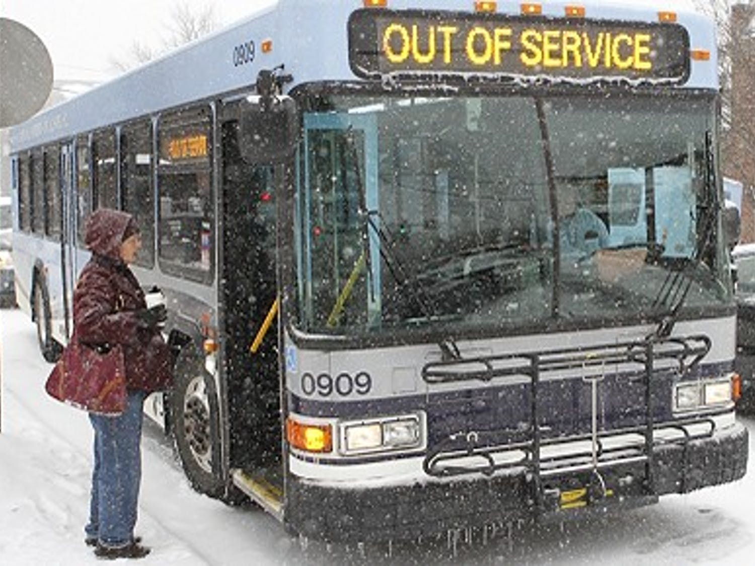 Heavy snow fall leaves busses closed and the Duke Basketball game postponed on Feb 12, 2014.