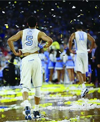 Seniors Marcus Paige (5) and Brice Johnson (11) walk off the court after the 74-77 loss against Villanova.