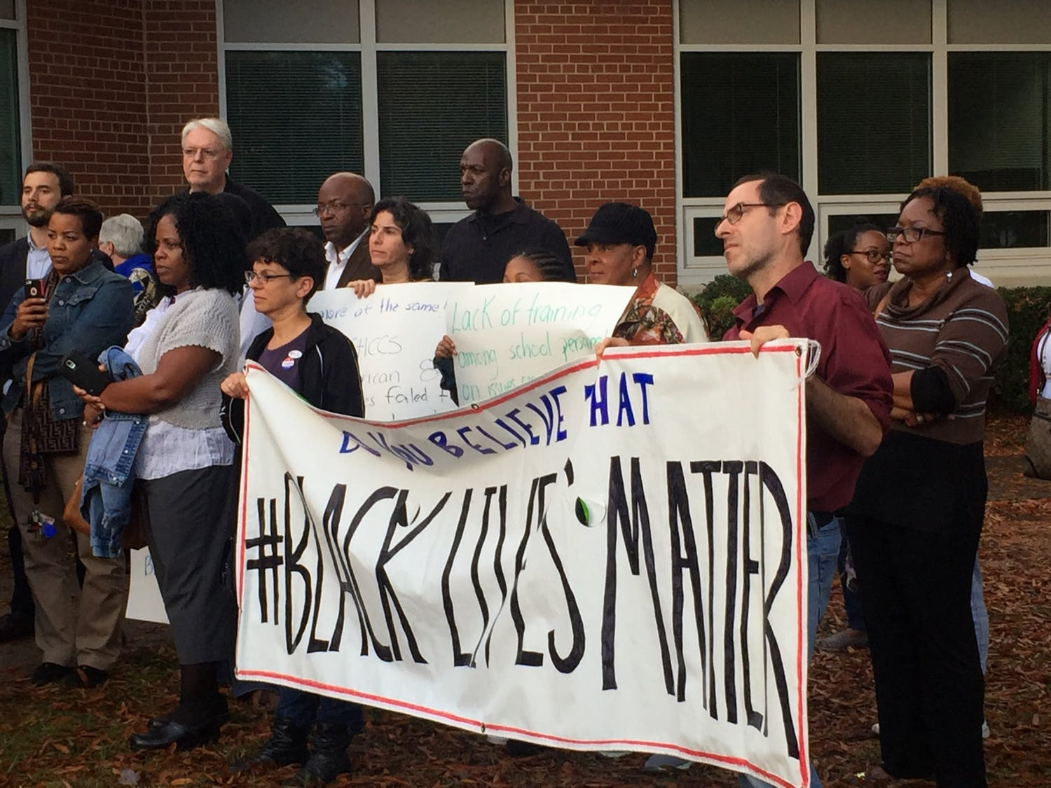 """Members of the Campaign for Racial Equity convened at a press conference on Oct. 28, 2015 in front of the Lincoln Center, the administrative building for Chapel Hill-Carrboro City Schools. The event marked the public release of the report """"Excellence With Equity: The Schools Our Children Deserve"""" that the Campaign for Racial Equity released."""
