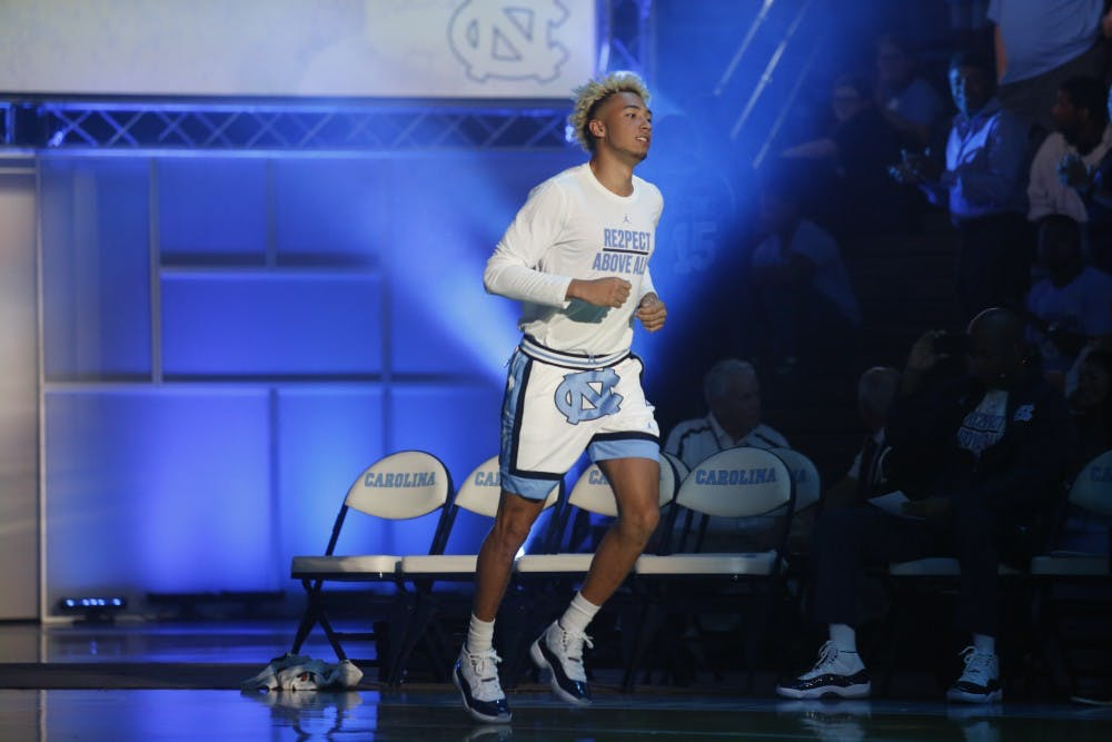 <p>UNC forward Shea Rush (11) runs onto the court during player presentations at Late Night With Roy on Oct. 13, 2017.&nbsp;</p>