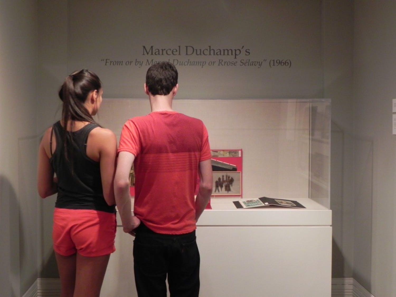 Visitors discuss the Ackland's Marcel Duchamp'sprized box artwork.