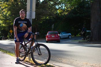 Sophomore math major Patrick Sasser keeps cool as he bikes in the Chapel Hill on Oct. 22, 2018.
