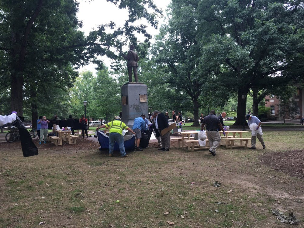 Signs and student belongings removed from in front of Silent Sam