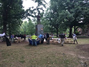 Signs and belongings were removed Thursday morning from around Silent Sam.