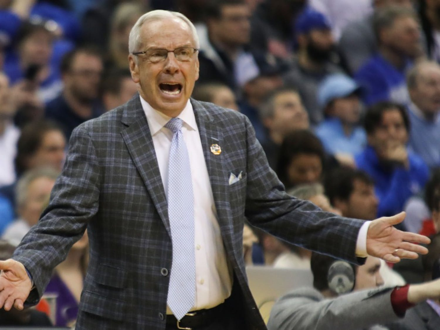 Head Coach Roy Williams yells to players and referees during UNC's 97-80 loss against Auburn in the Sweet 16 of the NCAA Tournament on Friday, March 29, 2019 at the Sprint Center in Kansas City, M.O.