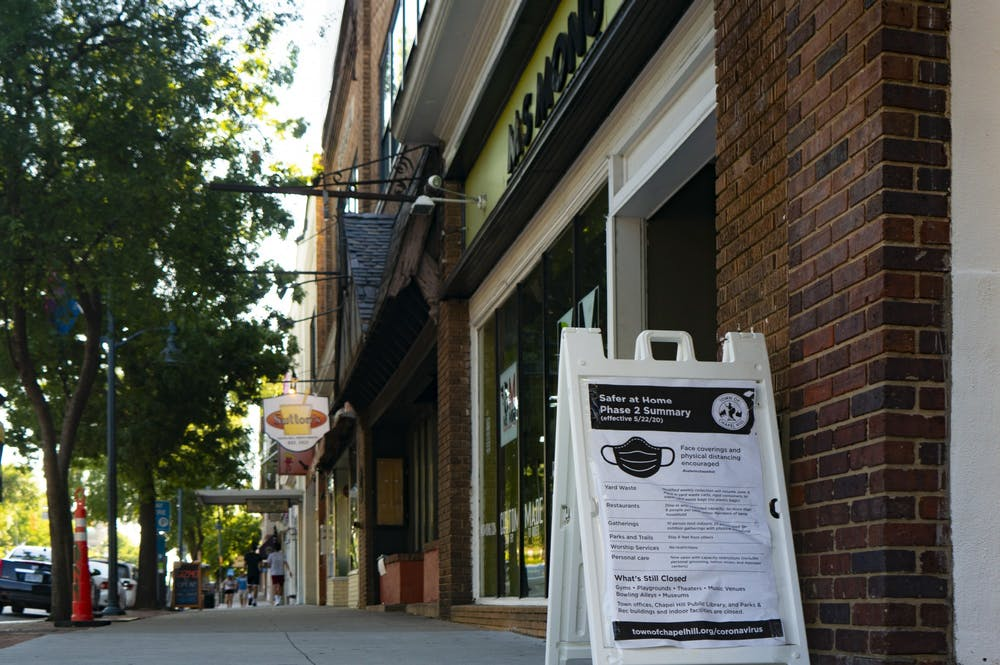 A sign on East Franklin Street provides information about safety precautions against COVID-19 on Sunday, June 7, 2020.